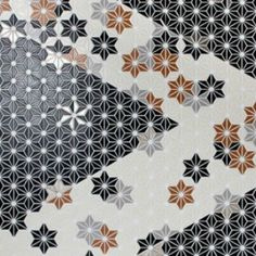 Inspired by Japanese design and architecture Hoshi from Soli USA is an interlocking mesh backed ceramic mosaic tile for floor and walls. The tile is stocked in black and white; additional colors are available for accents.