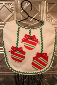 Christmas bib with decorative bulbs on Etsy, $6.00