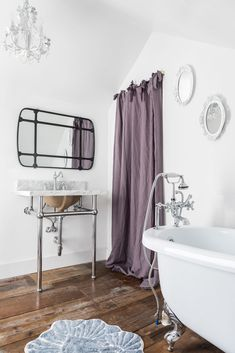"""""""The small white mirrors were old thrift store trays I upcycled, put mirror glass in, and painted white. The main mirror over the sink is from Painted Fox Home."""""""