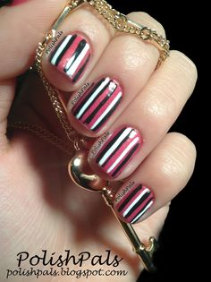 Pink, white, and black striped nails