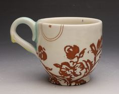 Another master with decals!  Elizabeth Robinson Wiley's work is  lovely in every respect. I especially love that yellow glaze dripping from the handle. Like melting butter. Yum!
