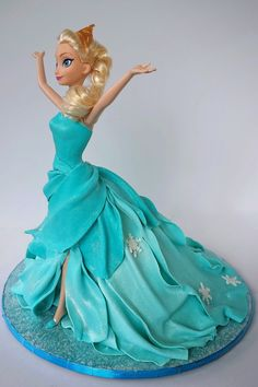 "I made this Elsa doll cake for my niece who absolutely loves Frozen . I was looking to replicate the scene where she sings ""Let it . Bolo Barbie, Barbie Cake, Bolo Frozen, Frozen Cake, Elsa Frozen, Fancy Cakes, Cute Cakes, Yummy Cakes, Fondant Cakes"