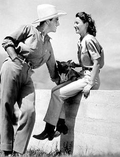 On a beautiful day in California Robert Taylor and Barbara Stanwyck enjoy their ranch