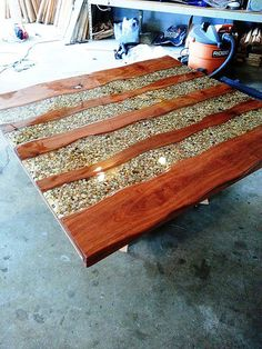 This would make an awesome outdoor table..River bend table, 06/17/14. cherry wood, hemlock, river stones, epoxy