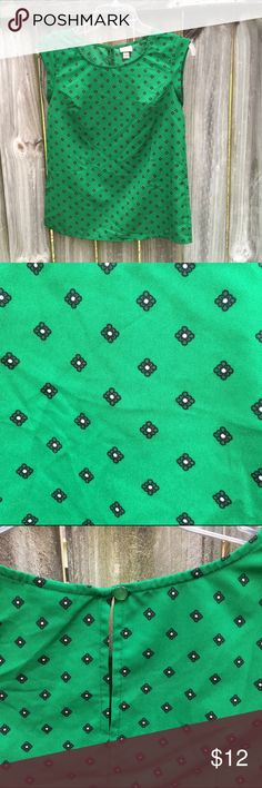 Patterned Green Shirt This pretty green shirt is made of a silly material and features a cool pattern to keep your outfit interesting. It has a little button and keyhole in the back for extra cuteness! Appropriate for work of casual wear. Only worn once. Merona Tops Tees - Short Sleeve
