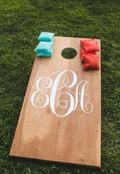 "At your wedding, monograms can represent an epic crest for your union. Find your initials in vintage-style marquees or reclaimed wood letters and display them near your guest book.  Make your own ""living monogram"" and fill it with succulents or even create a fun game of cornhole with a simple board painted with the initials of you and your lovey."