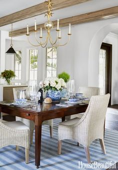 "The vintage Indian dhurrie from Madeline Weinrib ""brings age and history into the space.""Click through for more blue and white home decor and gorgeous pictures of this Naples home."