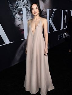 Dressed for the occasion  Dakota Johnson arrived to the Los Angeles  premiere of Fifty Shades Darker in a revealing but elegant dress on  Thursday night 3cdf20cdc7d