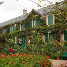 Claude Monet's House and Gardens Giverny, France tree outdoor sky green property house building flower home Garden residential area real estate cottage lawn yard Resort shrub