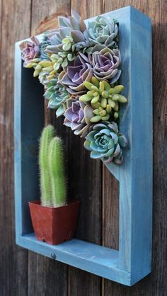 Love this unusual little garden decoration! Shelf Vertical planter Succulent garden 15 by SucculentWonderland