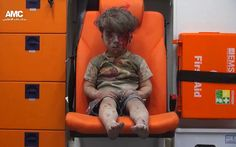 Here are the most influential, striking, and beautiful pictures from 2016. Five-year-old Omran Daqneesh sits in an ambulance after being pulled out of a building hit by an airstrike in Aleppo, Syria, on Aug. 17.