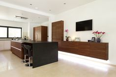 ALNO Starline walnut kitchen with black breakfast bar and return dropped leg to the floor