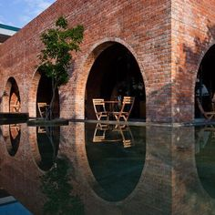F-Coffee is a café located in Dong Hoi, Vietnam which bears a mesmerizing design made by the Wangstudio architects. It is made up of red brick arches turned Arch Architecture, Amazing Architecture, Contemporary Architecture, Brick Cafe, Dong Hoi, Tadelakt, Brick And Stone, Concrete Stone, Brick Building