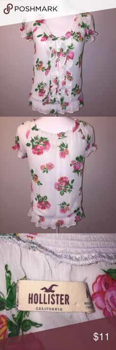 Hollister Floral Chiffon Ruffled Peasant Blouse This absolutely adorable top from Hollister is made of a sheer chiffon that is printed with beautiful flowers. It features lovely ruffled and cinched details. It is size M and is in excellent condition. If you have any questions, please ask! Hollister Tops Blouses