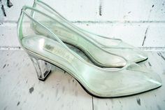 Nifty pair of size 8-1/2 vintage see through Cinderella pumps with a 3 Lucite heel and supple vinyl uppers. In very nice condition.  I gladly offer