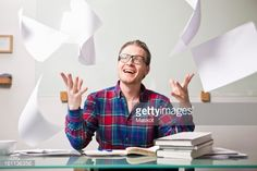 Stockfoto : Man throwing papers in air at office