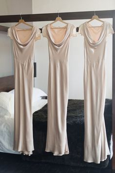 Pale pink Ghost bridesmaids dresses hanging in a row, Chateau Rigaud
