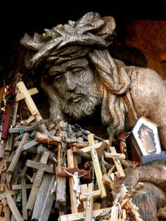 Hill of Crosses Lithuania  Eliana Dulins © 2006 - This wooden sculpture of Christ can be found at Lithuania's Hill of Crosses. This pilgrimage site is a place for Lithuanians and international travelers to pray or simply meditate.