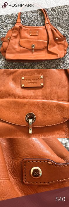 Kate Spade Brown Leather Shoulder Bag Camel brown leather shoulder bag by Kate Spade. Has some wear to it. Several pen stains on the inside as shown in the pictures. Small spots on the outside and bottom of bag as well. kate spade Bags Shoulder Bags