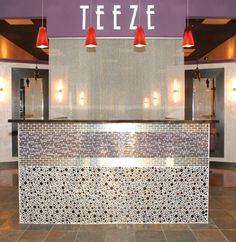 Glass or stone tiled front, logo behind, accent lighting