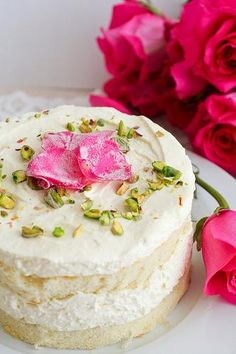 Persian Love Cake _ With Frosting & Candied Petals _ Adapted from Bon Appétit June The saffron, cardamom, rose, & pistachios give the dessert an exotic flavor. Food Cakes, Cupcake Cakes, Mini Cakes, Just Desserts, Delicious Desserts, Yummy Food, Slow Cooker Desserts, Beautiful Cakes, Amazing Cakes