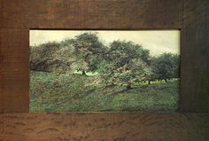 """CHARLES ROHLFS/EMMA KAAN Rohlfs rough-hewn oak frame with Kaan hand-colored engraving of orchard. Frame stamped R 1905, and print signed Emma Kaan. Frame: 28 1/2"""" x 19 1/2"""""""