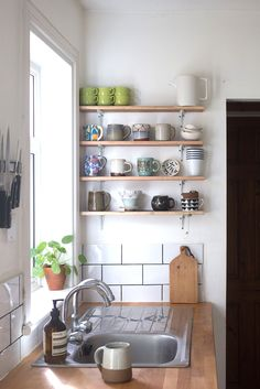 Miscellaneous mugs and all-wood-everything make for a minimal but sweet kitchen corner in interior stylist Hannah Bullivant's home.