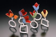 "Enamel Rings  from Color Series: Dissemblance  1999  fine silver, enamel, glass  each approx. 1.5"" x 2"" x .5""  one-of-a-kind  private collections"