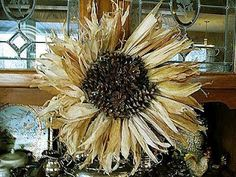How awesome is this wreath made out of corn husks and pine cones.