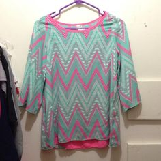 Hot pink and teal flow-y top - size M A super cute top from Cavender's, NWT. Light blue/teal, hot pink, and white chevron pattern. The back has a pleated design with an all hot pink part. Sleeves reach the elbows and are very loose. Breathable fabric, size M. R. Rouge Tops Blouses