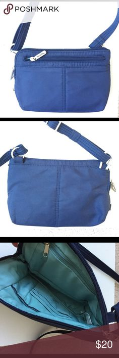 TravelOn Anti-theft Small Cross-body Waistpack Excellent condition. Great for travel. Converts from cross-body to waist pack. Security latch on main zipper compartment. RFID blocking to protect credit cards and passports. Travelon Bags Crossbody Bags