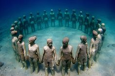 isla-mujeres-dive-underwater-museum3 - The underwater sculptures are the work of Mexico-based British sculptor Jason deCaires Taylor. In 2006, Taylor founded and created the world's first underwater sculpture park off the coast of Grenada in the West Indies. 5 years later National Geographic now lists it as one of the Top 25 Wonders of the World. His second project MUSA was also subsequently described by Forbes in 2011 as one of the world's most unique travel destinations.
