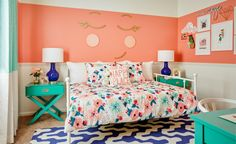 Whimsical big girl room design that's full of fun colors like coral and aqua and super fun accents and decor.