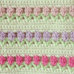 Tulip Stitch, free crochet pattern from a Red Heart freebie here: http://www.redheart.com/free-patterns/flowers-row