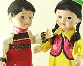 These rare and unique dolls are dressed in all original ethnic clothing with bright beautiful colours. Sold as a pair (in original boxes) they will make a great addition to your vintage doll collection. They are about 8.5 inches tall, stand on their own and are made of a shiny composition material.