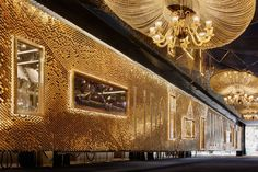 Giles Miller Studio's most opulent and extravagant project to date: a 30m long ceramic installation on the Champs Elysees.