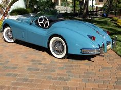 Great looking Jaguar XK 140 Roadster.