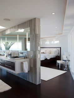 Modern Master Suite want a wardrobe behind the bed (fake wall) but don't like the