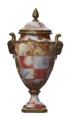 A RARE COALPORT SIMULATED AGATE SPECIMEN VASE, CIRCA 1900 With gilded acorn finial and rams mask handles, painted to an exhibition standard with simulated agate specimen panels framed with gilded and moulded borders.