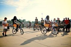 Players ride kids' bikes to practice ... a Packer training camp tradition