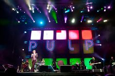 """Pulp at Coachella: """"Pulp! Are an extremely good band, right? And have you heard that Jarvis Cocker is ridiculously charming? A thrower of poses, grapes, and banter. The recent reunitees brought all of this to the mainstage along with a pretty major laser and light show, holding everyone's attention through a lull through back catalog wanders until a triumphant """"Common People"""" finale."""" Sad I can't be there."""