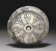 AN ACHAEMENID REPOUSSÉ SILVER LOTUS BOWL -  EARLY 5TH CENTURY B.C.