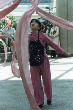 A Chinese performer at the indoor skyway park in St. Paul, MN.  Film-based photo.  Early 80's.