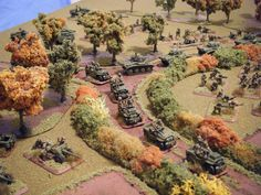 So here's my Flames of War airlanding company. I went for an autumnal theme for the terrain, to go wi. Wargaming Table, Wargaming Terrain, Bolt Action Game, Desert Diorama, Bolt Action Miniatures, Game Terrain, 40k Terrain, Model Training, Scale Model Ships