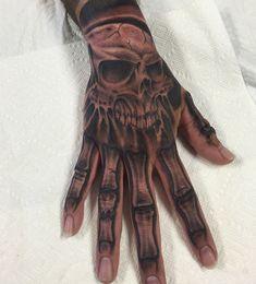 Skull Bone Hand Tattoo skull hand tattoos designs ideas and meaning ...
