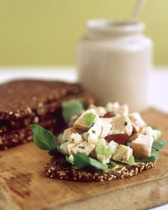 Chicken Salad Sandwich by Martha Stewart. In a bowl, combine yogurt, mustard, chives, tarragon, and remaining salt-pepper mixture. Core apple, and cut into 1/4-inch dice. Place apple in a medium bowl with lemon juice, and toss to combine. Add fennel, celery, and grapes. Cut reserved chicken into 1/2-inch pieces. Add to salad with yogurt dressing; stir to combine. Divide salad among 6 slices pumpernickel bread, and sprinkle with watercress.