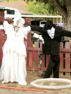 Bride and groom scarecrows!