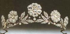 Strathmore Rose Tiara. Lady Elizabeth Bowes-Lyon (the future Queen Elizabeth, the Queen Mother) received it as a gift from her father, the Earl of Strathmore, for her wedding in 1923, though the piece itself dates from before that. The tiara features a garland of wild roses in diamonds mounted in silver and gold. The individual elements can be dismantled and worn as brooches, and according to Hugh Roberts were originally able to be substituted by single sapphires.