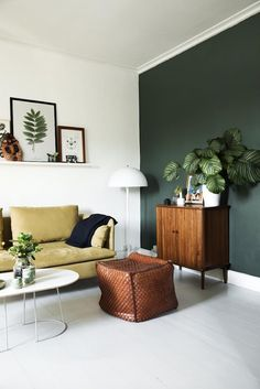 my scandinavian home: yellow and dark green sitting room in the relaxed Danish home of Line Stützer