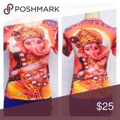 Lord Ganesh top Beautiful printed God shirt on front and back  Vibrant colors to keep your soul energized 🙏. Doesn't have a size tags . As these are from India . Would be perfect for size Small or medium . 👍Measures🔹Armpit to Armpit : 16.5🔹Length :22. 👍Brand new but No tags as that's how it's sold in India . Tops Tees - Short Sleeve